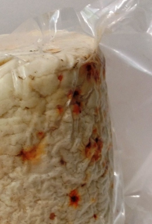 Dry Anthoryros cheese of Crete with mediterranean chili
